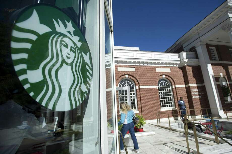 A customer enters the Starbucks store, at 96 Broad St., adjacent to the Ferguson Library, in downtown Stamford, Conn., on Thursday, Oct. 18, 2018. The coffee shop is permanently closing at 8 p.m. on Monday, Oct. 22, 2018. Photo: Michael Cummo / Hearst Connecticut Media / Stamford Advocate