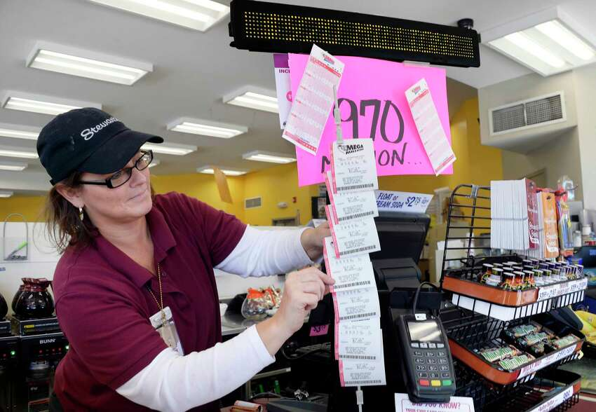 Store manager Corey Wasula sets up a Mega Millions display at the Vischer Ferry Stewart's Shop as the jackpot hits $970 million Thursday Oct. 18, 2018 in Clifton Park, NY. (John Carl D'Annibale/Times Union)