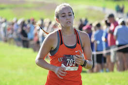 Edwardsville's Hannah Stuart is on her way to a fourth-place finish in the Edwardsville Invitational on Sept. 15 at SIUE.