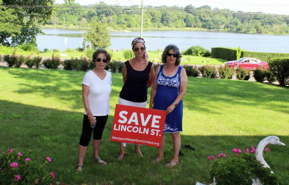 Residents Mary Anne Liesner, Tina Torraco, and Joan Miller, all members of the group, Westport Neighbors United LLC, stand in the front yard of Torraco's home on Westport's Riverside Avenue on Aug. 6. Photo: Sophie Vaughan / Hearst Connecticut Media / Westport News