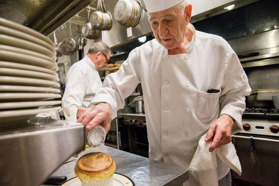Executive Chef Pierre Palomes puts the finishing touches on the restaurant's Grand Marnier souffle, his signature dessert. He makes dozens a night. Photo: Jessica Christian / The Chronicle