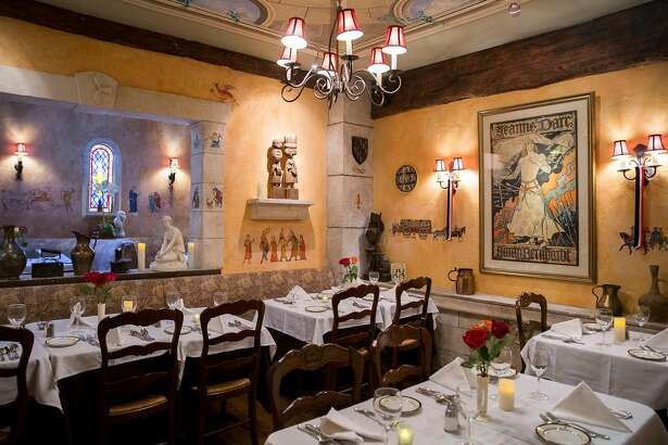 Paintings and other various works of art line the walls of the dining room at Jeanne d'Arc restaurant inside Cornell Hotel de France in San Francisco, Calif. Wednesday, Oct. 17, 2018.