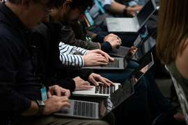 Tech writers take type on laptops during Amazon's release event for new Alexa products and services at The Spheres in Seattle on September 20, 2018. - Amazon weaves its Alexa digital assistant into more services and devices as it unveiles new products powered by artificial intelligence including a smart microwave and dash-mounted car gadget. (Photo by Grant HINDSLEY / AFP)GRANT HINDSLEY/AFP/Getty Images