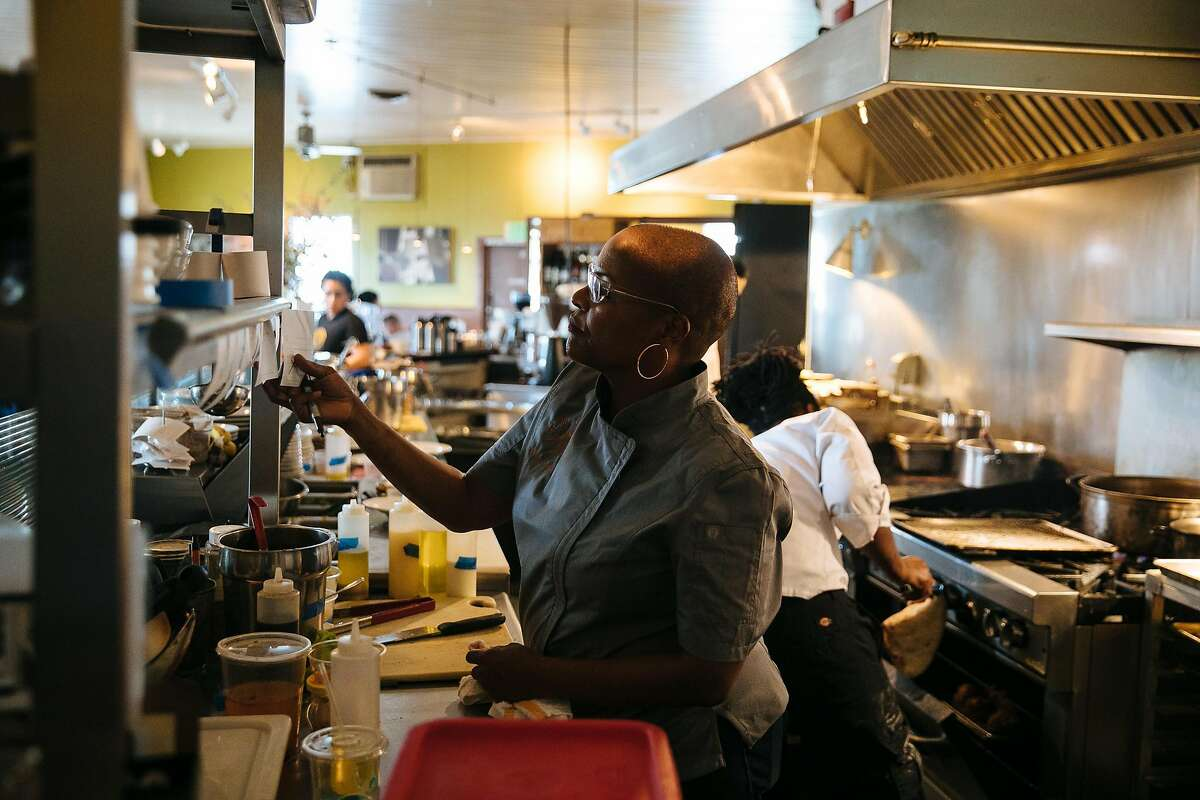 Tanya Holland checks on incoming orders she helps prepare food at her restaurant, Brown Sugar Kitchen, in Oakland, Calif. Friday, November 10, 2017.