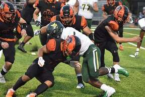 Edwardsville defensive back Jalen Cooper, left, lowers his shoulder to try and tackle the Waubonsie Valley running back during a Sept. 14 game inside the District 7 Sports Complex.