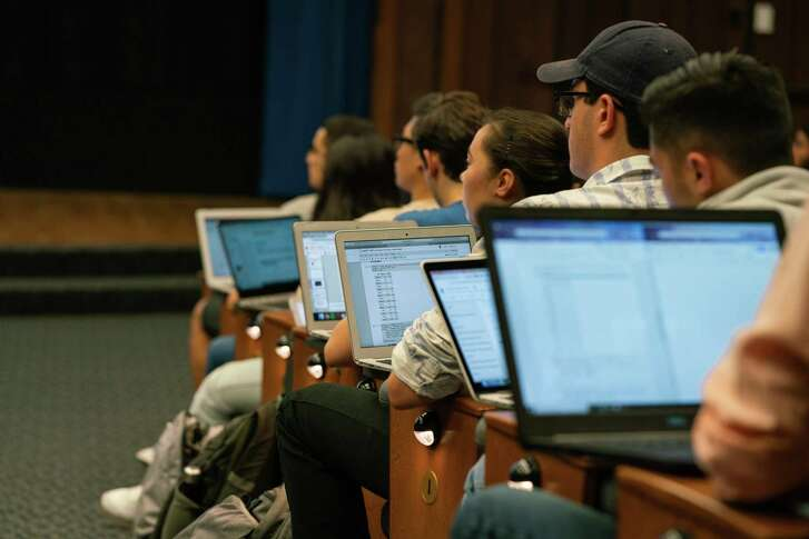 Students listen to a lecture on the foundations of data science at UC Berkeley's Wheeler Hall Auditorium. The program has grown in popularity as employers increasingly seek to hire data scientists.
