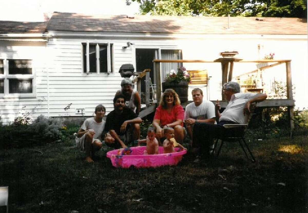 Some of Sara Tracey's family - from left, mom, dad, grandma, aunt, uncle, grandpa, with Sara Tracey and her twin Hannah in the pool - in the backyard of the Glenville home. It had belonged to Sara's grandparents, and now belongs to her and her boyfriend. (Provided)