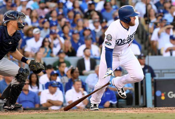 The Los Angeles Dodgers' Max Muncy drives in the go-ahead run against the Milwaukee Brewers in the sixth inning during Game 5 of the National League Championship Series at Dodger Stadium in Los Angeles on Wednesday, Oct. 17, 2018. The Dodgers won, 5-2, for a 3-2 series lead. (Wally Skalij/Los Angeles Times/TNS)