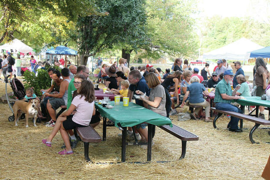 Leclaire Parkfest visitors fill the tables as they enjoy a snack at a previous event. Photo: Intelligencer Photo