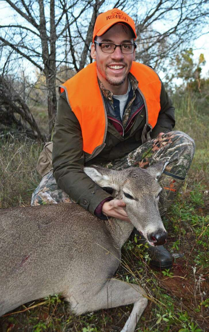 Displaying one of two does he shot during a Mentored Hunting Workshop that caters to novice adults, Ralston Dorn, a Dallas paramedic, now hunts on his own.