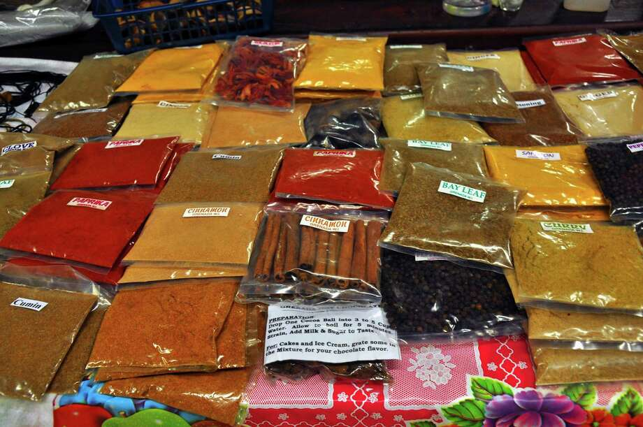 "An array of spices is offered for sale at the market in St. George's, capital of Grenada, ""The Spice Island."" (Katherine Rodeghier/Chicago Tribune/TNS) Photo: Katherine Rodeghier / Chicago Tribune"