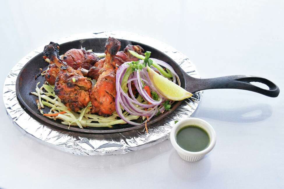 Tandoori chicken half at Aromas Indo-Chinese restaurant Wednesday Oct. 10, 2018 in Colonie, NY. (John Carl D'Annibale/Times Union)