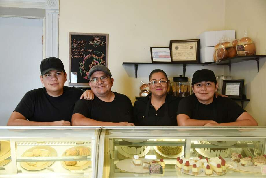 Rodrigo and Lidia Rodriguez are shown in their Laredo bakery, Rodriguez & Fam. Scartch Bakery, with their two sons. Photo: Christian Alejandro Ocampo