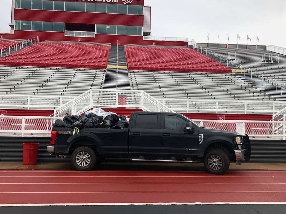 Code Red Community members helped clean Cougar Stadium after Crosby High School's first game in September. Photo: Courtesy: David Givans