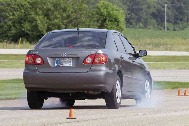The driving clinic at the Houston police academy familiarizes young drivers with their car's handling and braking limits, how physics affect the vehicle, and how to better maintain control in unpredictable situations.