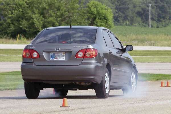 The driving clinic at the Houston police academy familiarizes young drivers with their car's handling and braking limits, how physics affects the vehicle, and how to better maintain control in unpredictable situations.