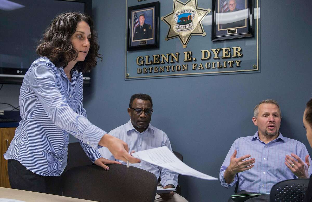 Alameda County Public Defender's Office social worker Sascha Atkins-Loria prepares a group of client's advocates before registering inmates to vote at Glenn Dyer Detention Facility in Oakland, Calif. Friday, Oct. 12, 2018.