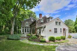 The home at 500 Cutlers Farm Road in Monroe has a history that stretches back more than 250 years. It was built in 1760 by Abner Seeley, heir to Captain Nathaniel Seeley who lost his life during King Philip's War in 1675. Nathaniel Seeley's family was given a parcel of land, part of which is now the house at 500 Cutlers Farm Road, for his service. The 2,530-square-foot Colonial has since been renovated and restored a few times, but retains several of its original elements, including some of its wide-plank chestnut floors and a single stone hearth measuring about 12 feet.