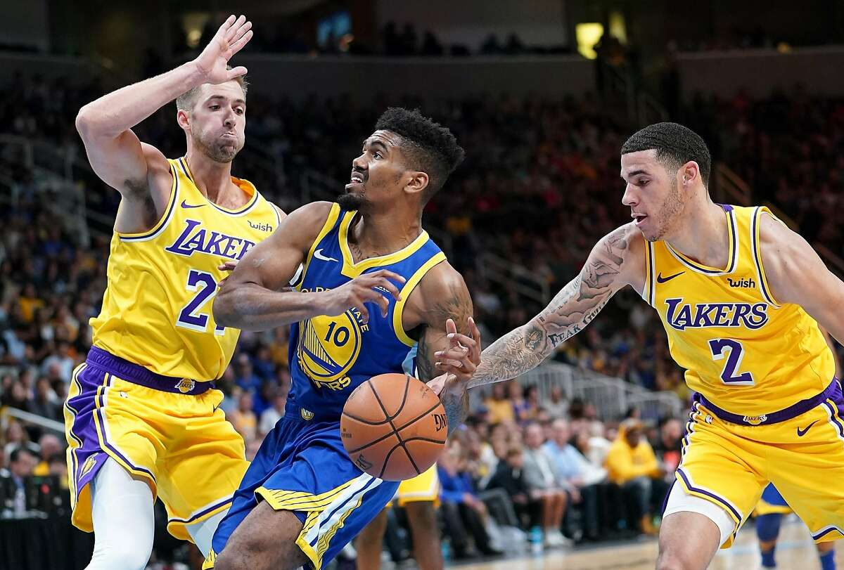 SAN JOSE, CA - OCTOBER 12: Jacob Evans #10 of the Golden State Warriors drives on Travis Wear #21 and has the ball slapped away by Lonzo Ball #2 of the Los Angeles Lakers during the second half of their NBA preseason basketball game at SAP Center on October 12, 2018 in San Jose, California. NOTE TO USER: User expressly acknowledges and agrees that, by downloading and or using this photograph, User is consenting to the terms and conditions of the Getty Images License Agreement. (Photo by Thearon W. Henderson/Getty Images)