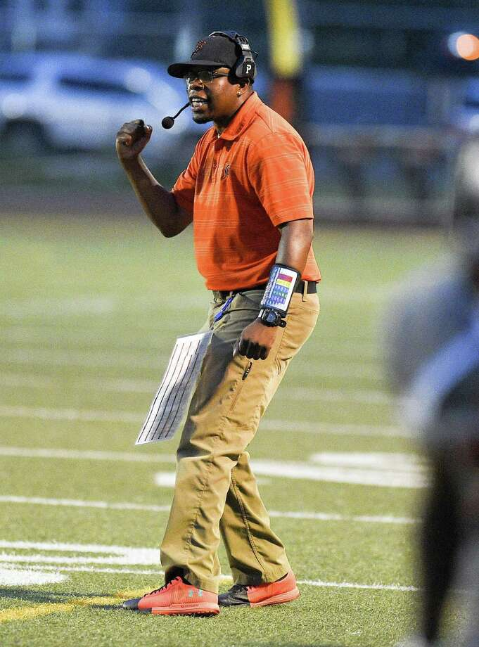 Stamford coach Jamar Greene celebrates after a Black Knights touchdown against Fairfield Warde during on Sept. 7 at Boyle Stadium in Stamford. Photo: Matthew Brown / Hearst Connecticut Media / Stamford Advocate