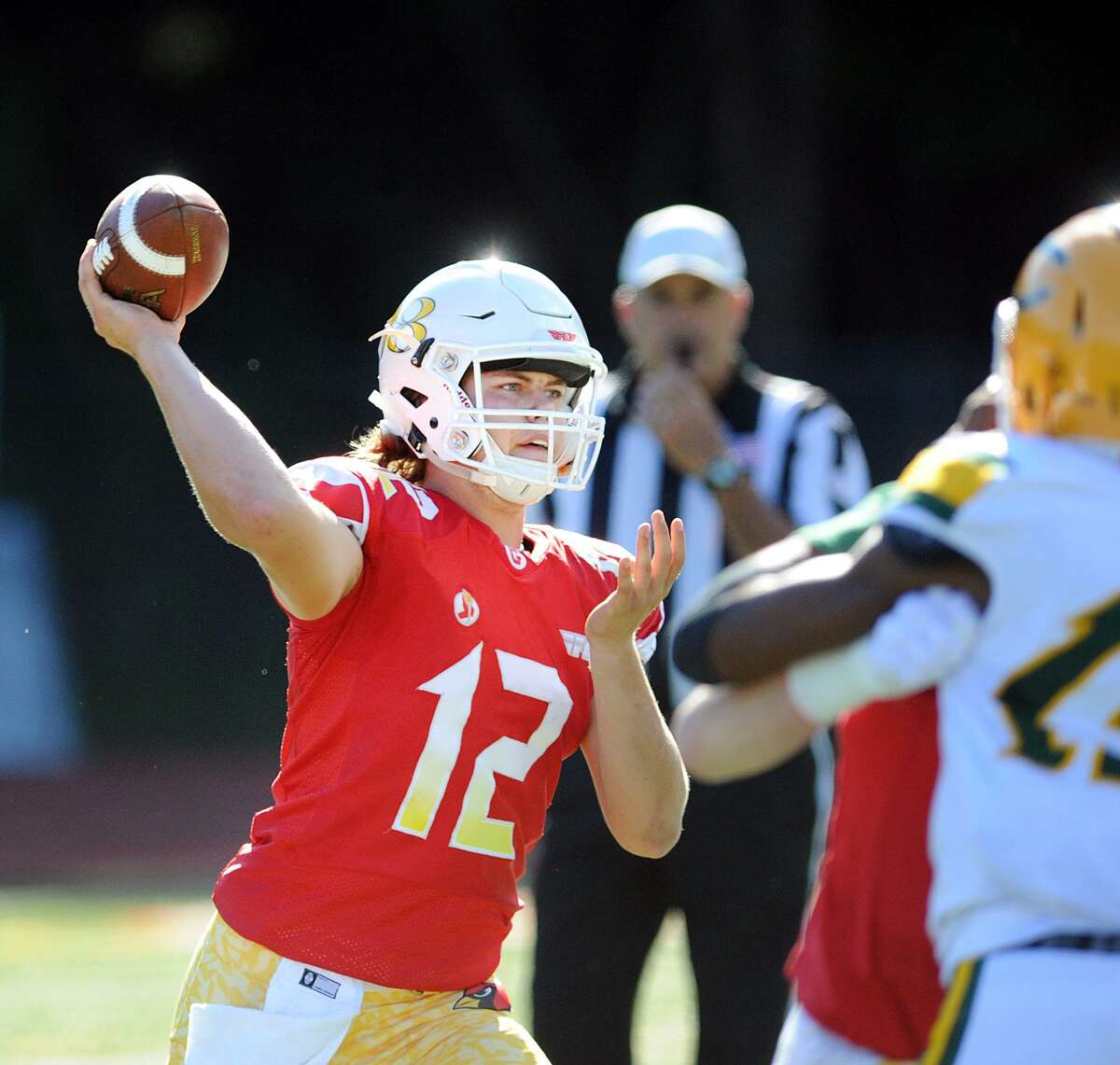 Greenwich quarterback Gavin Muir makes a throw against Trinity Catholic on Sept. 15.