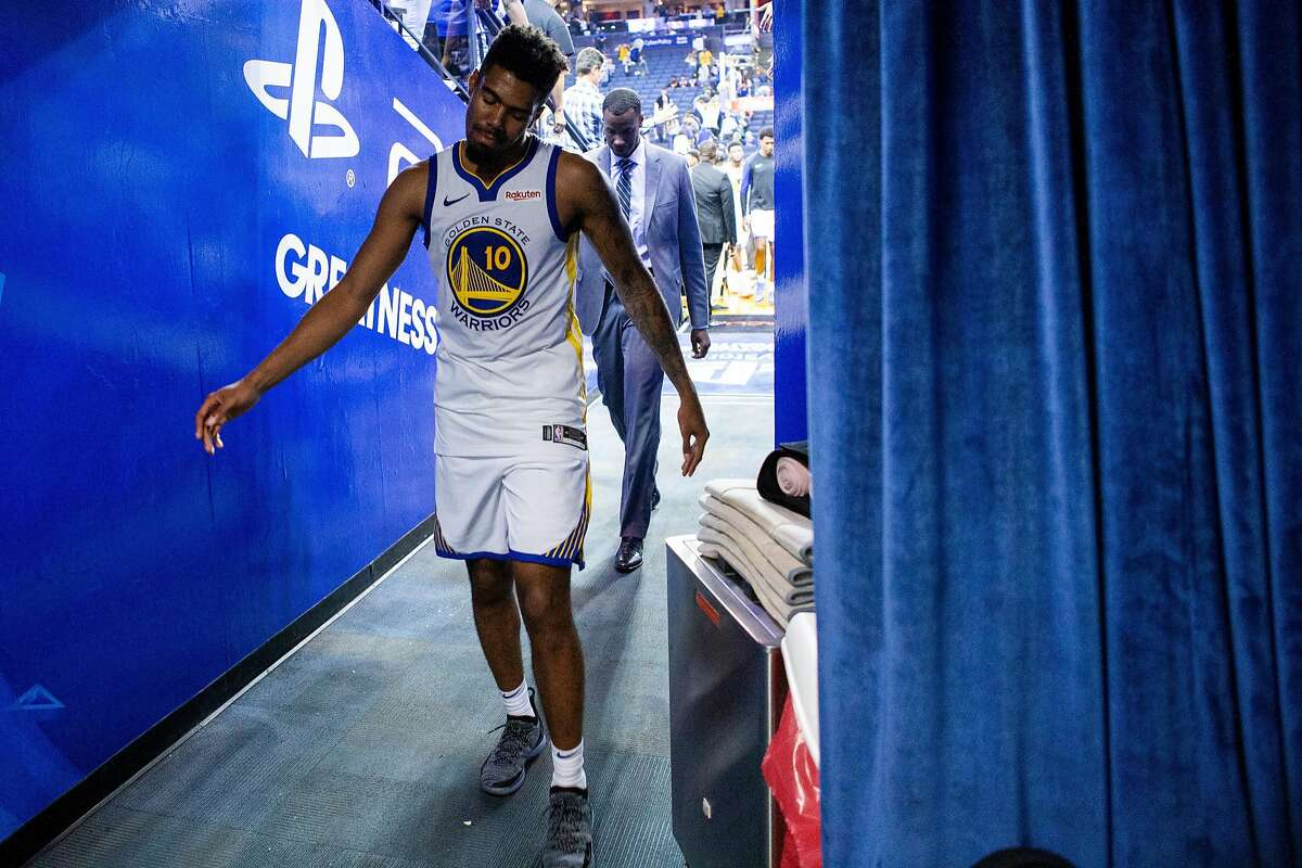 Golden State Warriors guard Jacob Evans III (10) exits to the locker room following the NBA preseason game between the Golden State Warriors and Minnesota Timberwolves at Oracle Arena on Saturday, Sept. 29, 2018, in Oakland, Calif. The Minnesota Timberwolves won 114-110.