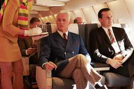 Smoking on planes was common during the Mad Men era, but was banned in the 1990s.