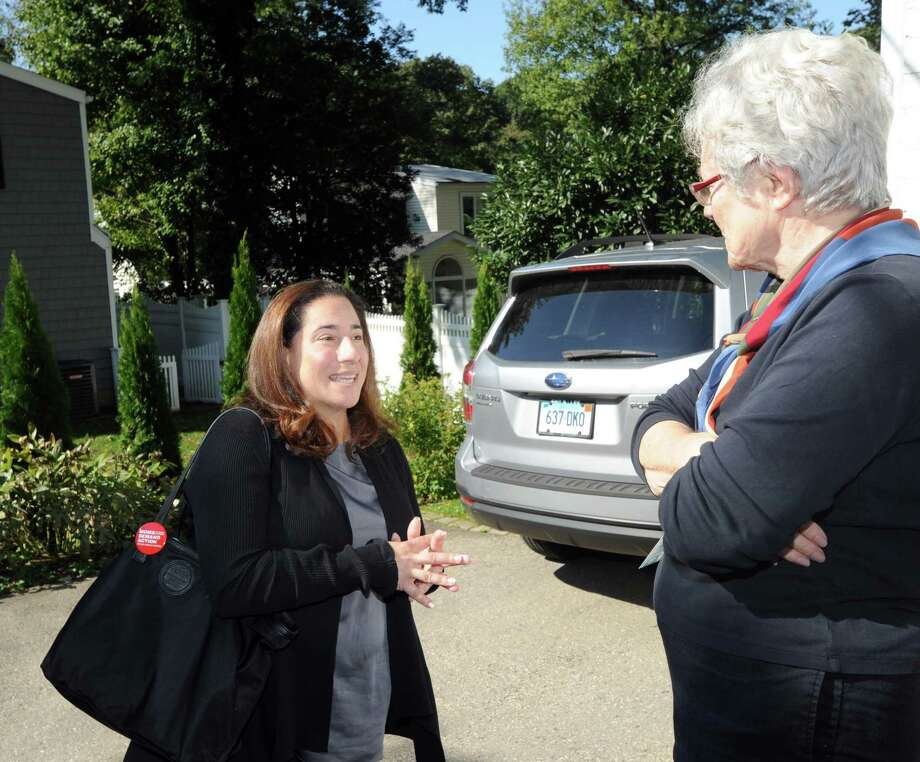 At left, Laura Kostin, the Democratic candidate running for State Representative for District 151, speaks to potential voter Lynn Brown, while canvassing on Halsey Drive in Old Greenwich, Conn., Wednesday, Oct. 17, 2018. Photo: Bob Luckey Jr. / Hearst Connecticut Media / Greenwich Time