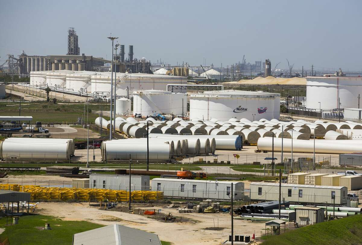 Oil storage tanks and wind turbine components line a portion of the main channel of the Port of Corpus Christi near the Harbor Bridge, Wednesday, March 7, 2018, in Corpus Christi. ( Mark Mulligan / Houston Chronicle )