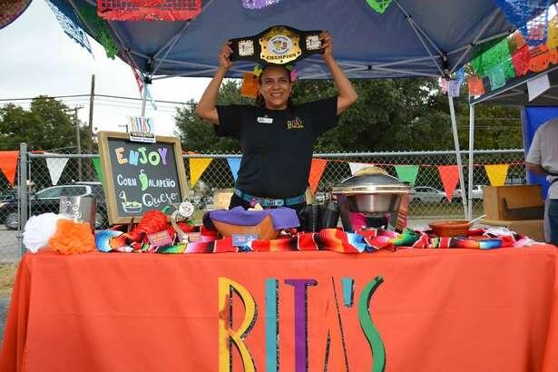 Janet Yanez of Rita's on the River celebrates the restaurant's 2017 Queso Meltdown win.