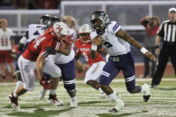 Port Neches-Groves quarterback Roschon Johnson breaks for the end zone during a first quarter drive in the Indians?' game Friday night at Crosby. (Mike Tobias/The Enterprise)