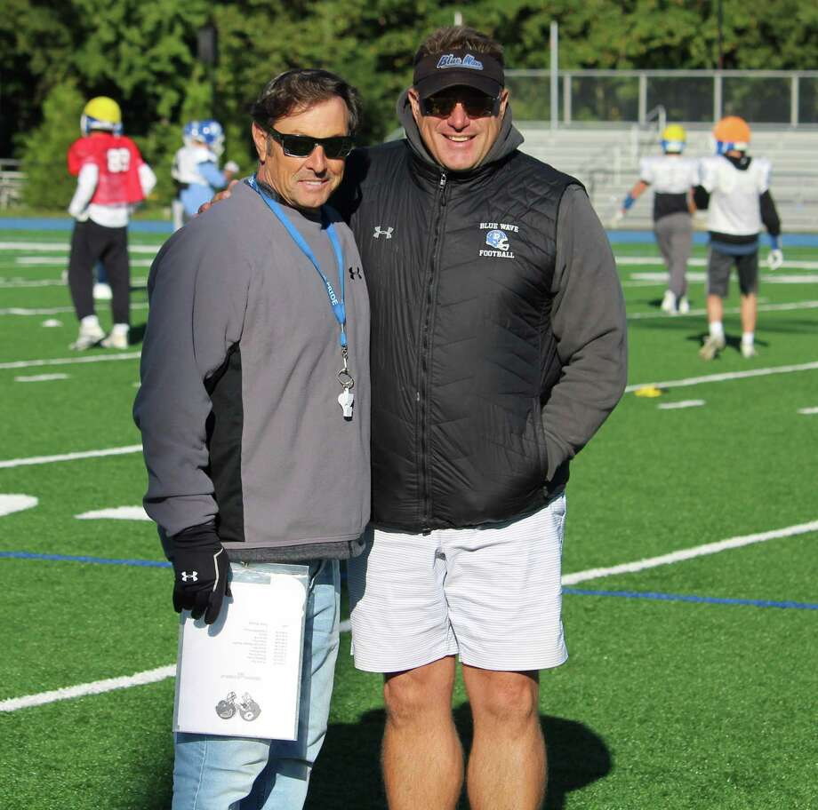 Darien coach Rob Trifone (left) and Defensive Coordinator Mike Forget pose at practice on Thursday, Oct. 18, 2018 at Darien High School in Darien, Conn. Photo: Anthony E. Parelli / Hearst Connecticut Media / Darien News