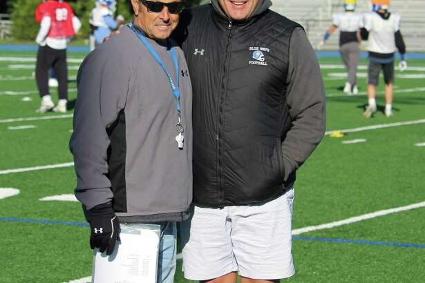 Darien coach Rob Trifone (left) and Defensive Coordinator Mike Forget pose at practice on Thursday, Oct. 18, 2018 at Darien High School in Darien, Conn.