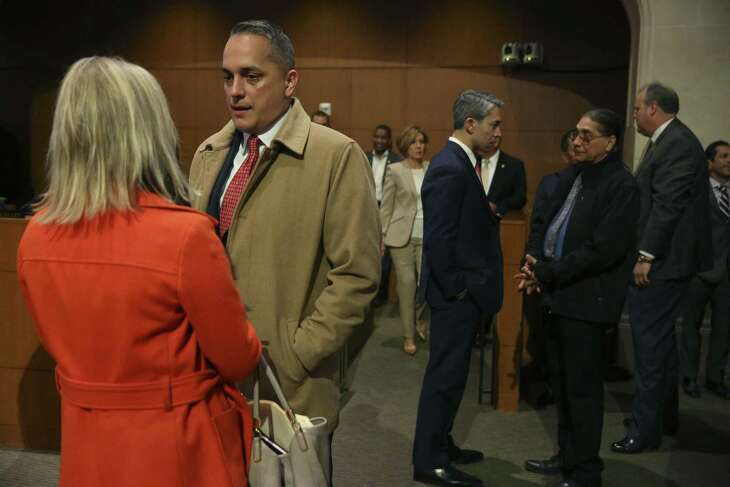 San Antonio City Council District 6 Member Greg Brockhouse, center left, and Mayor Ron Nirenberg, center right, mingle before the start of a City Council meeting Oct. 18. Brockhouse is challenged Nirenberg's bid for reelection in the May 4 elections. They had their first debate Friday morning at KTSA radio.