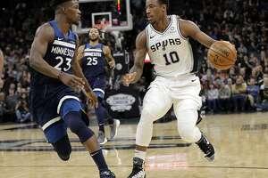 San Antonio Spurs guard DeMar DeRozan (10) and Minnesota Timberwolves guard Jimmy Butler (23) during the second half of an NBA basketball game, Wednesday, Oct. 17, 2018, in San Antonio. San Antonio won 112-108. (AP Photo/Eric Gay)