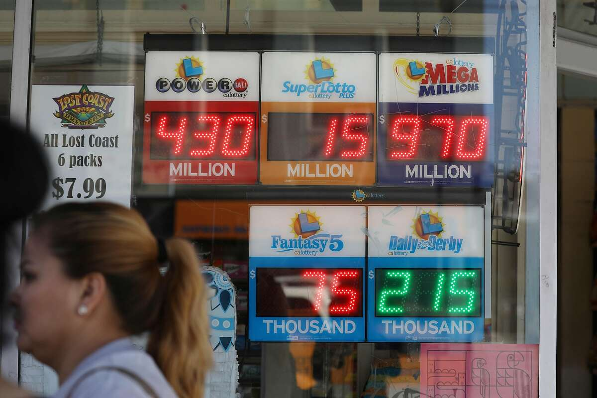 The amount of the Mega Millions jackpot is displayed in a market window on Mission Street on Thursday, October 18, 2018 in San Francisco, Calif.