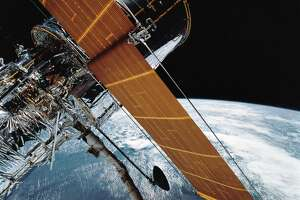 In this April 25, 1990 file photo provided by NASA, most of the giant Hubble Space Telescope can be seen as it is suspended in space by Discovery's Remote Manipulator System (RMS) following the deployment of part of its solar panels and antennae. The Hubble Space Telescope has been sidelined by a pointing system failure. NASA announced Monday, Oct. 8, 2018, that one of Hubbles gyroscopes shut down on Friday, Oct. 5. As a result, Hubble is in so-called safe mode, where it's still orbiting but with non-essential systems turned off. That means all astronomy observations are on hold. (NASA via AP, File)