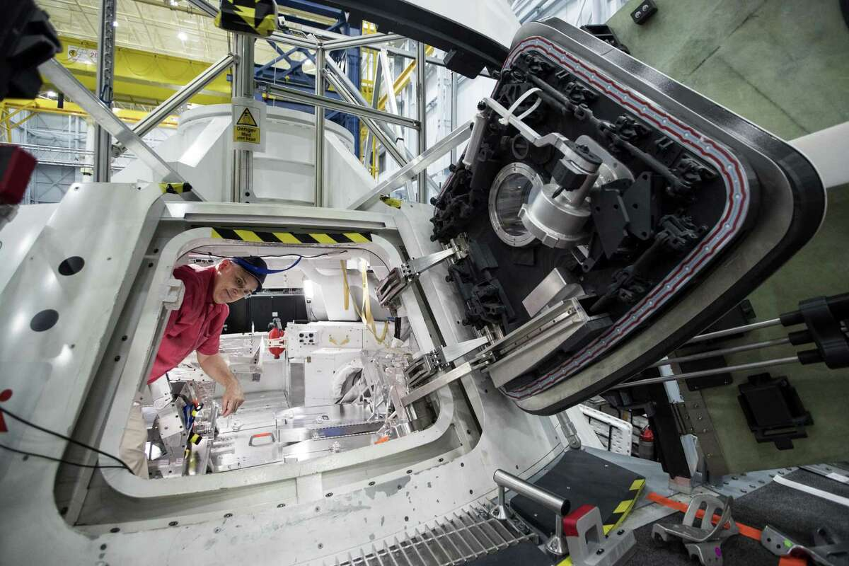 Lee Morin, astronaut mission specialist and supervisor of the Rapid Prototyping Lab, gives a tour of the Orion capsule mock-up at NASA's Johnson Space Center on April 26, 2018, in Houston.