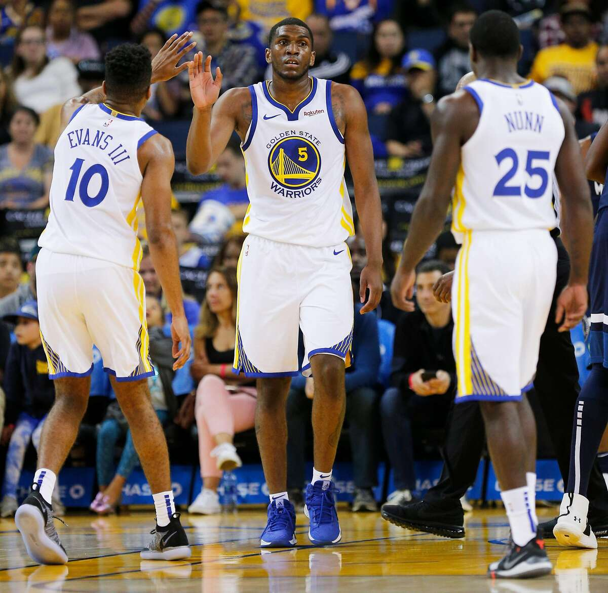 Golden State Warriors forward Kevon Looney (5) during the second half of an NBA preseason game between the Golden State Warriors and Minnesota Timberwolves at Oracle Arena on Saturday, Sept. 29, 2018, in Oakland, Calif. The Minnesota Timberwolves won 114-110. Also photographed are Warriors guard Jacob Evans III (10) and guard Kendrick Nunn (25)