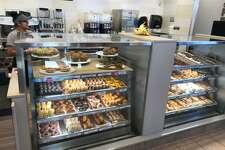 "One of the changes to the Dunkin' Donuts ""store of the future"" is placing the baked good right in front of the customer rather than far behind the counter. The display case shown here is at the chain's location at 1101 North Colony Road in Wallingford."