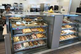 """One of the changes to the Dunkin' Donuts """"store of the future"""" is placing the baked good right in front of the customer rather than far behind the counter. The display case shown here is at the chain's location at 1101 North Colony Road in Wallingford."""