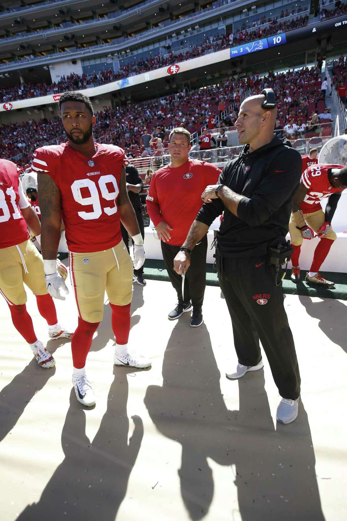 SANTA CLARA, CA - SEPTEMBER 16: DeForest Buckner #99 and Defensive Coordinator Robert Saleh of the San Francisco 49ers stand on the sideline during the game against the Detroit Lions at Levi Stadium on September 16, 2018 in Santa Clara, California. The 49ers defeated the Lions 30-27. (Photo by Michael Zagaris/San Francisco 49ers/Getty Images)