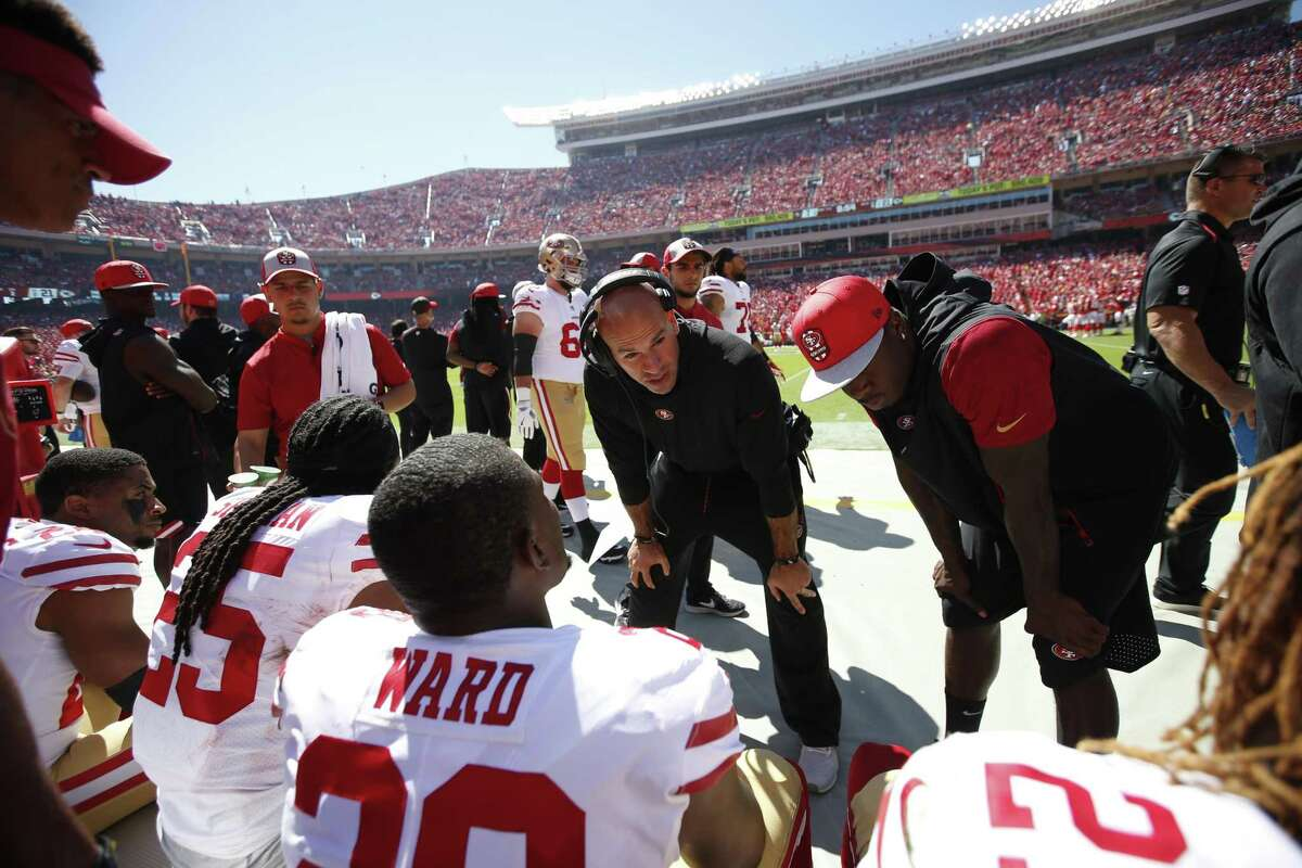 KANSAS CITY, MO - SEPTEMBER 23: Defensive Coordinator Robert Saleh of the San Francisco 49ers talks with the defensive backs on the sideline during the game against the Kansas City Chiefs at Arrowhead Stadium on September 23, 2018 in Kansas City, Missouri. The Chiefs defeated the 49ers 38-27. (Photo by Michael Zagaris/San Francisco 49ers/Getty Images)