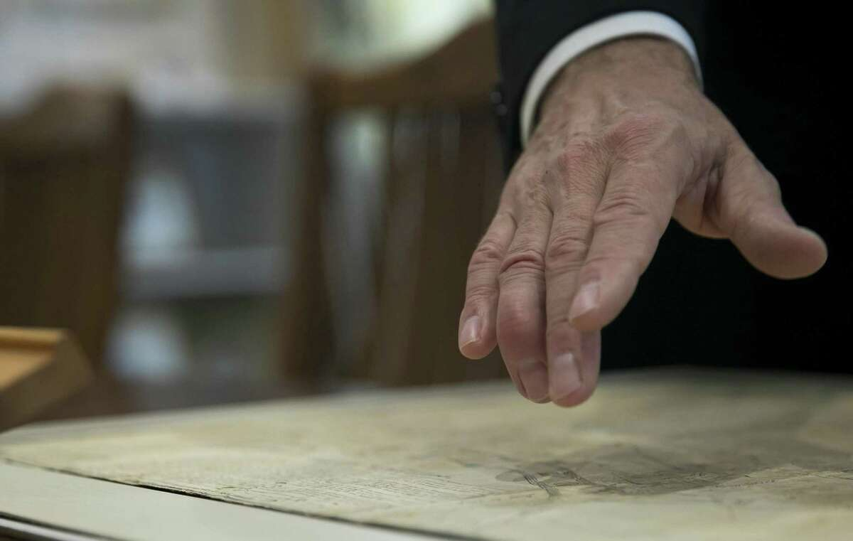 Ed Grusnis, owner of the Antiquarium in River Oaks, points out details on one of the original maps of Houston created by the Allen brothers in his store on Thursday, Oct. 18, 2018, in Houston.