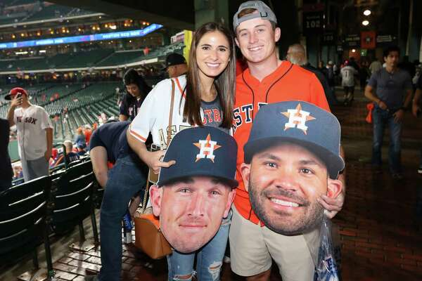 Houston Astros fans pose for a photograph before Game 5 of the American League Championship Series at Minute Maid Parkon Thursday, Oct. 18, 2018, in Houston.