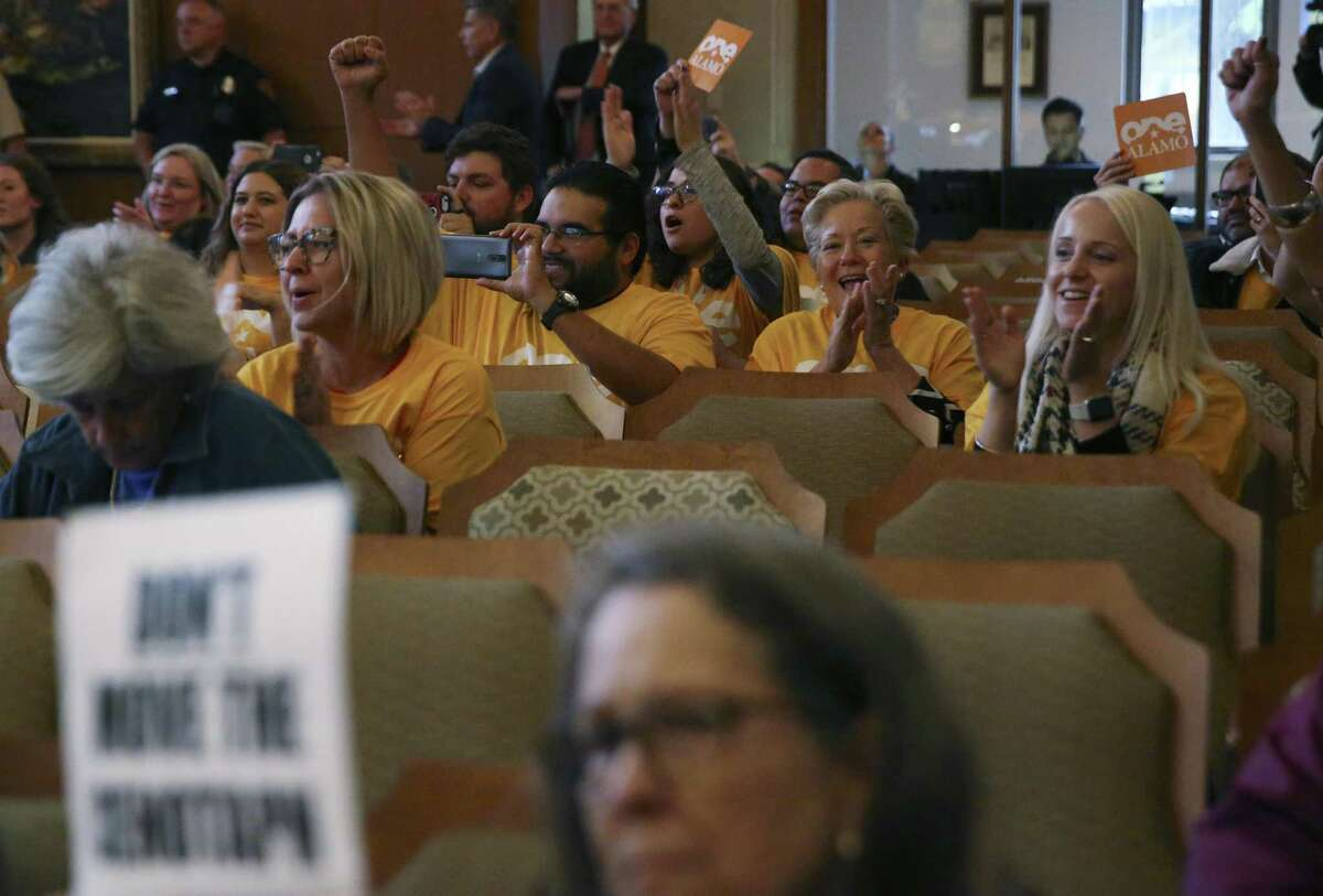 Supporters react as the Alamo Plan is approved during a San Antonio City Council meeting, Thursday, Oct. 18, 2018. The council voted 9-2 with Council members Clayton Perry and John Courage voting against it.