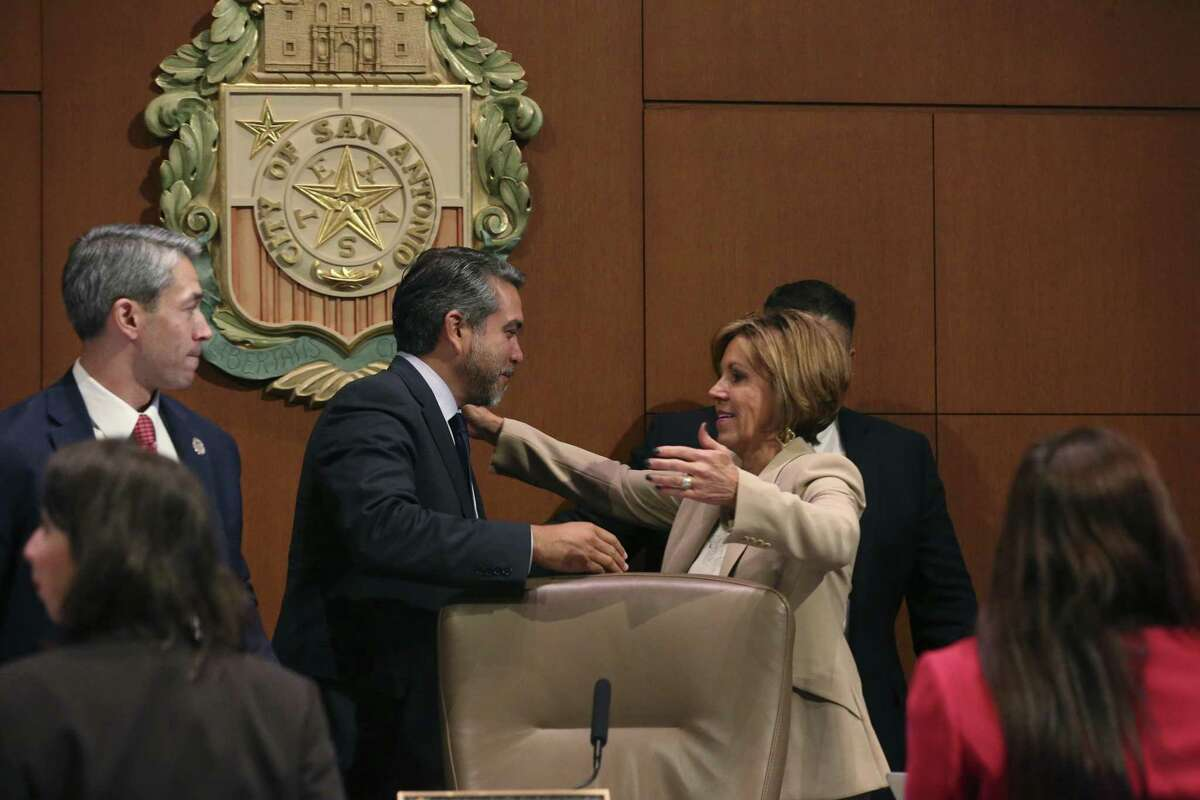 San Antonio City Manager Sheryl Sculley reaches out to hug City Council Member Roberto C. Treviño after the Alamo Plan is approved during a San Antonio City Council meeting, Thursday, Oct. 18, 2018. The council voted 9-2 with Council members Clayton Perry and John Courage voting against it. Mayor Ron Nirenberg in on the left.