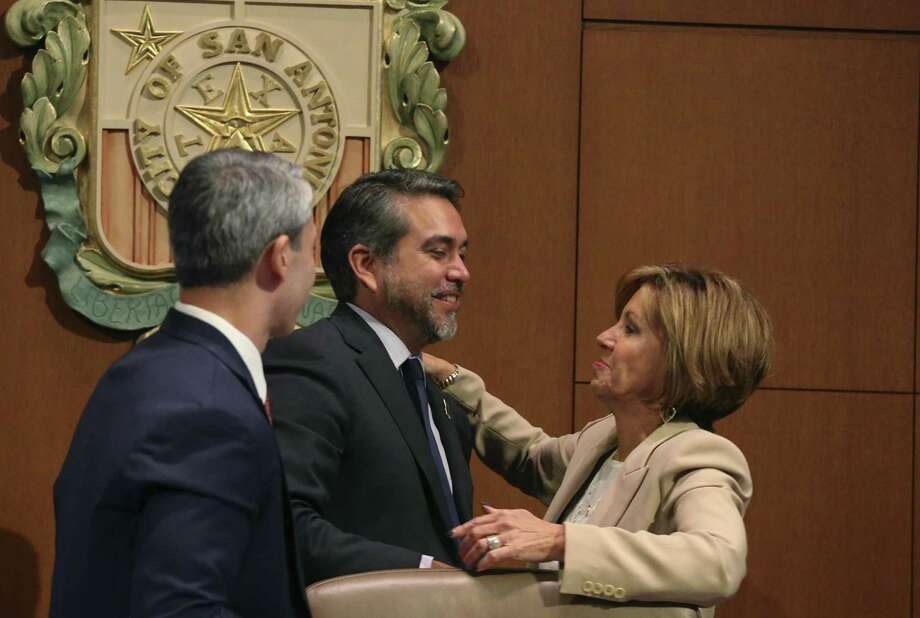 San Antonio City Manager Sheryl Sculley reaches out to hug City Council Member Roberto C. Treviño after the Alamo Plan is approved during a San Antonio City Council meeting, Oct. 18. Mayor Ron Nirenberg in on the left. Treviño led the councils effort on the plan. Not everyone is celebrating this decision. Photo: JERRY LARA /San Antonio Express-News / © 2018 San Antonio Express-News