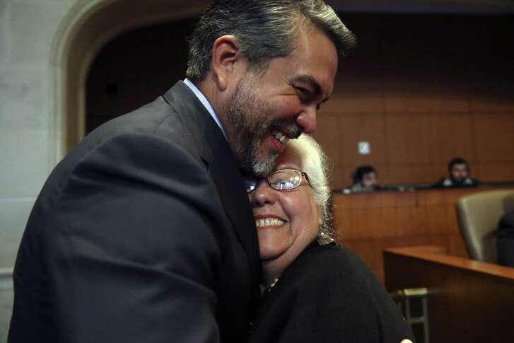 People react as the Alamo Plan is approved during a San Antonio City Council meeting, Thursday, Oct. 18, 2018.