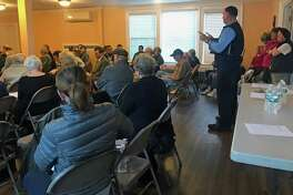 Scott Appleby (right) addresses the crowd gathered in Bridgeport, Conn., on Oct. 18, 2018, to discuss the flooding on Sept. 25.